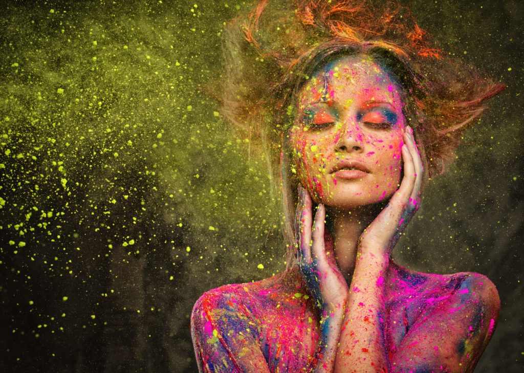 Woman with closed eyes and paint splatters